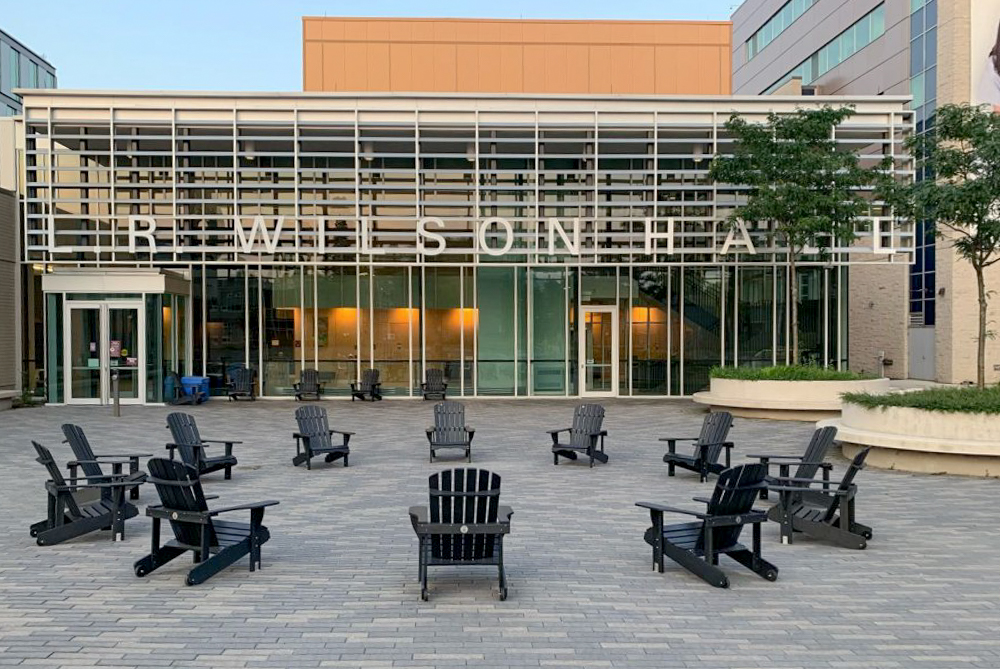 Muskoka chairs in front of L.R. Wilson Hall