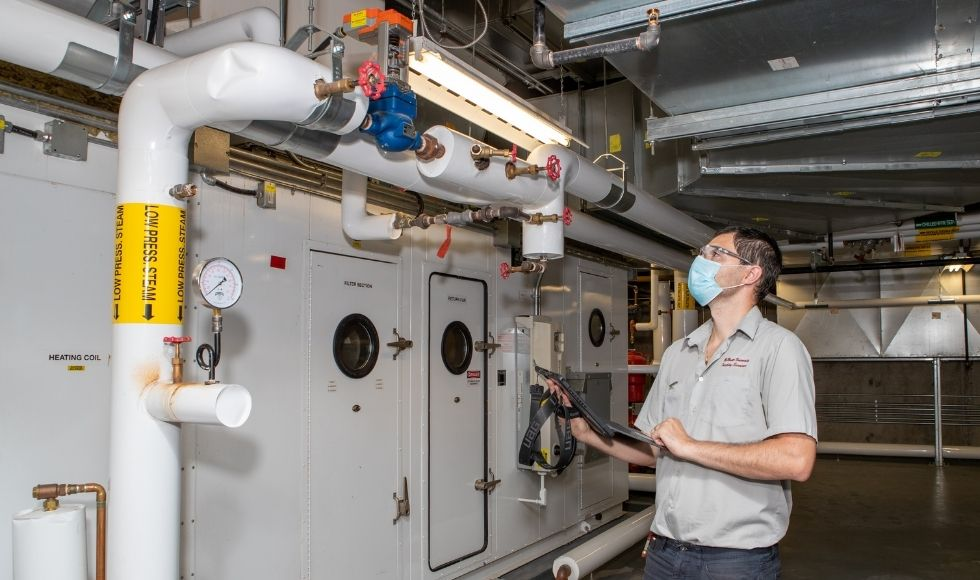 Utility Services assessing ventilation systems